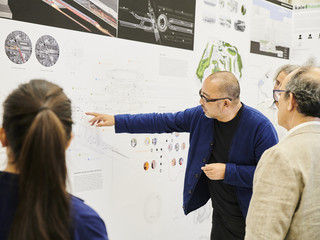 Faculty showing guests work from his studio at the end of year exhibition