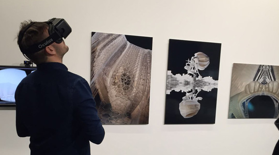Image of Benjamin Ennemoser viewing the VR experience at an exhibition at the Bartlett School of Architecture in London