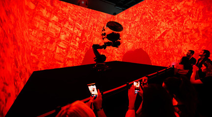 Image of a robotic display lit with red light