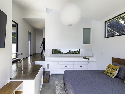 Interior image of a bedroom looking through to a hallway