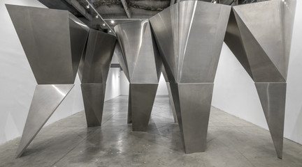 Image of En Pointe, an installation of a group of large, angular aluminum-clad columns at the SCI-Arc Gallery in Los Angeles.