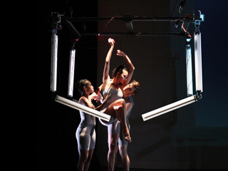 Image of dancers interacting with robotic arms