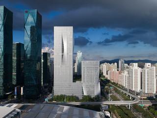 Exterior shot of a building in the Shenzen skyline.